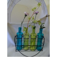 COLLECTION OF 4 COLORED GLASS BOTTLES WITH BLACK METAL HOLDER W. HANDLE-INSIDE/O   372381140640